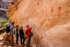 HMI Gap students admiring ancient petroglyphs