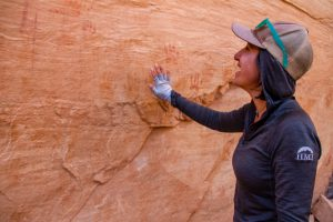 HMI Gap instructor admiring petroglyphs